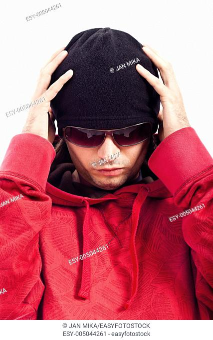 Detail of Hip Hop dancer in red hoody, black hut and sunglasses