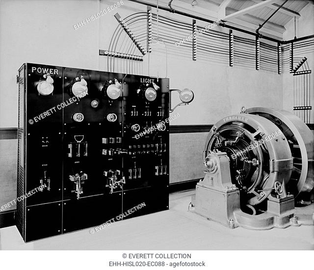 Control panel and dynamo (generator) of a self-contained electric power station that might be used for a large house or small factory before electricity was...