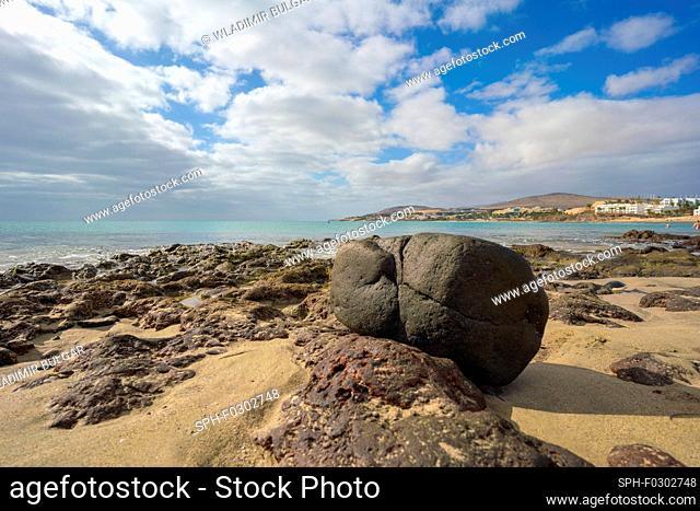 Boulder on a sandy beach
