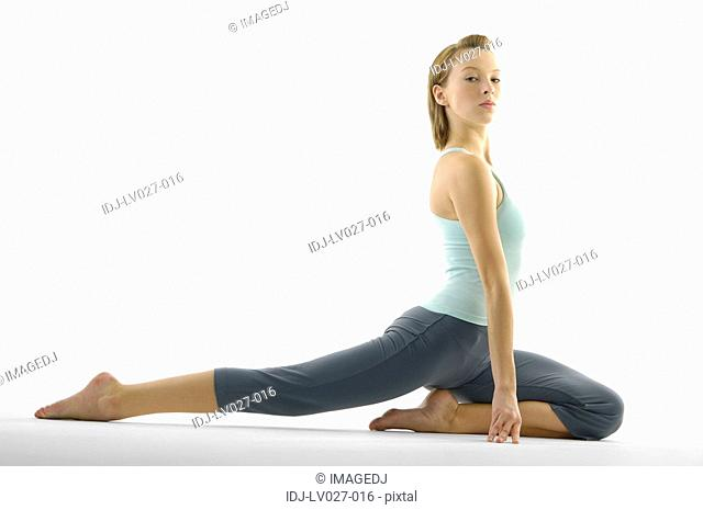Portrait of a young woman practicing yoga