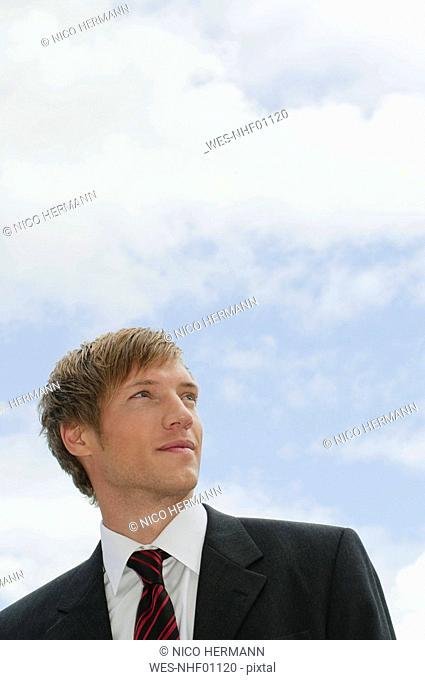 Germany, Bavaria, Businessman looking away, portrait, close-up