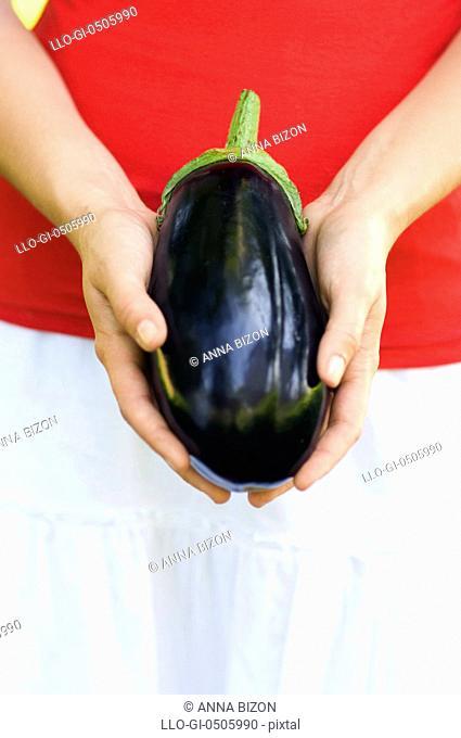 Eggplant in hand, Debica, Poland
