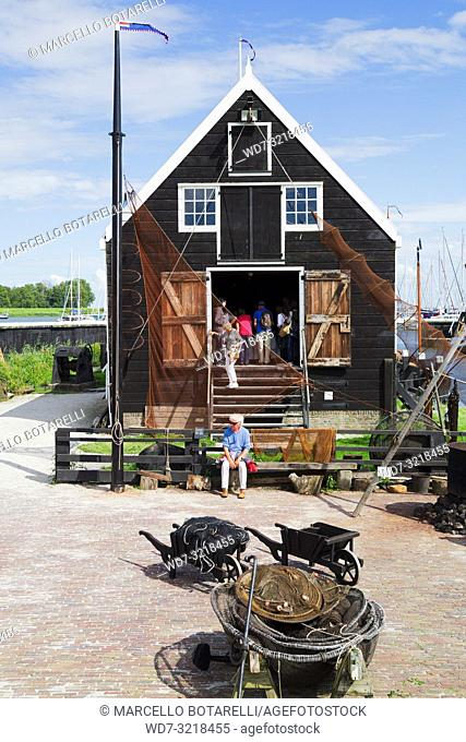 fishing museum, exposed fishing nets, enkhuizen, a small town in northern holland, an ancient fishing town
