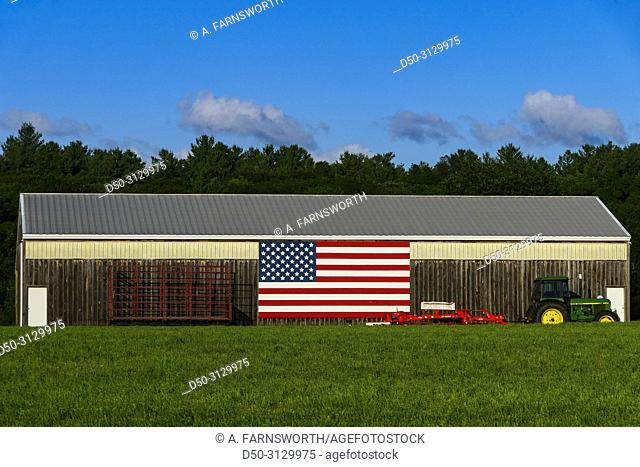 Concord, Massachusetts, USA An American flag strewn over a barn