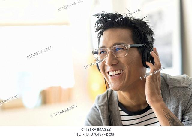 Cheerful man listening to music