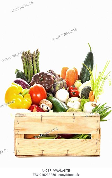 Assortment of fresh vegetables in a crate