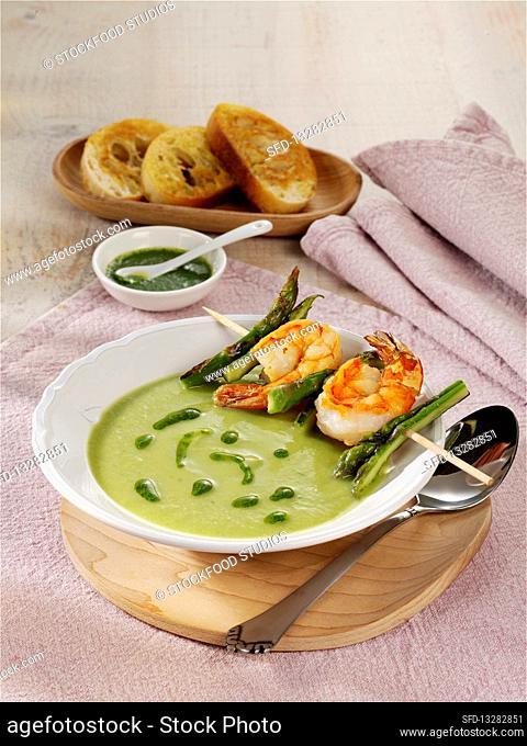 Green asparagus gazpacho with prawn skewers