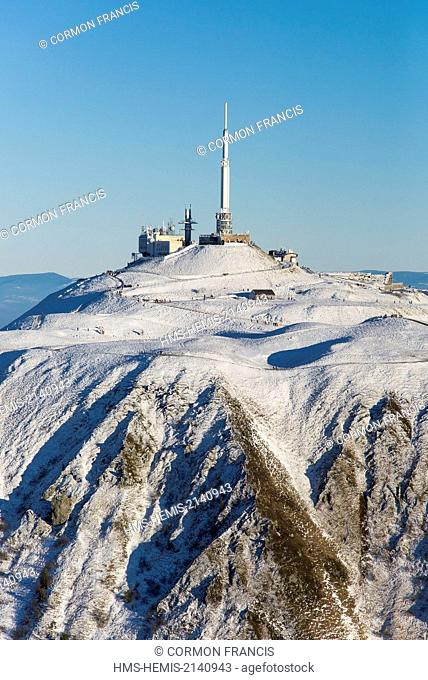 France, Puy de Dome, Orcines, Chaine des Puys, Regional Natural Park of the Auvergne Volcanoes, the snow covered Puy de Dome (aerial view)