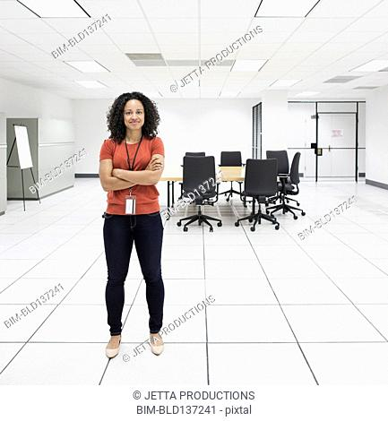 Mixed race businesswoman smiling in conference room