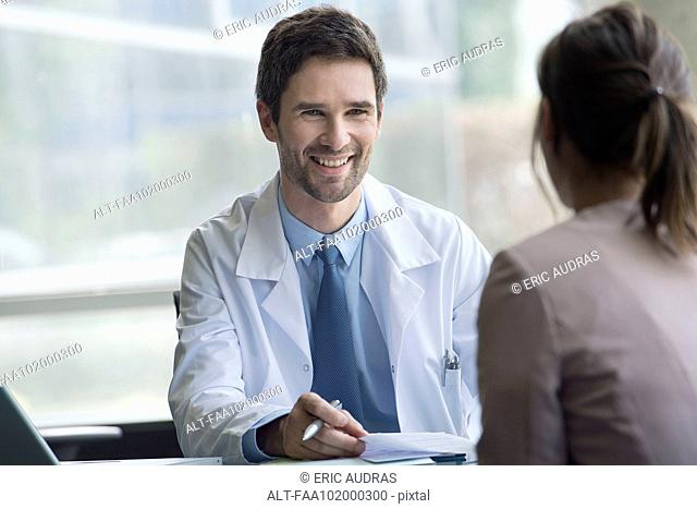 Healthcare worker meeting with patient in office