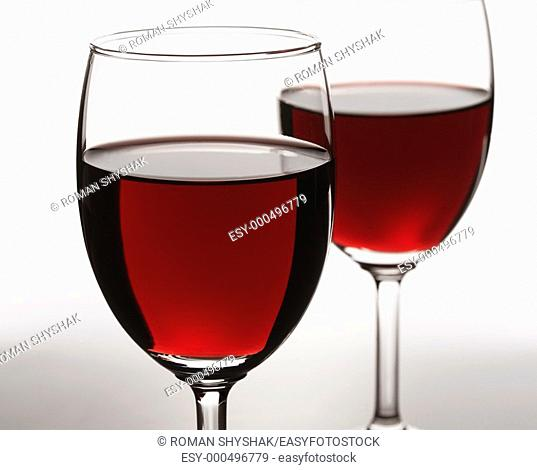 Red wine on white background  Focus is on the first glass