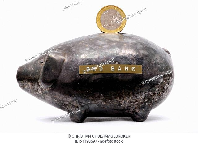 Black piggy bank with Euro coins, 'Bad Bank' written on it