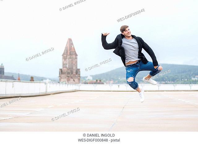 Happy young man jumping mid-air