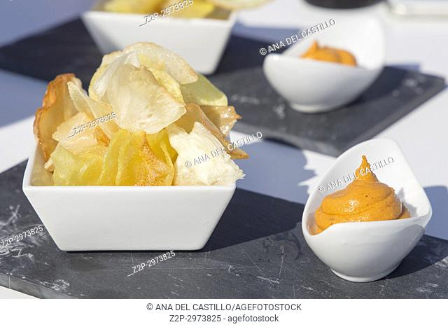 Batata chips with sauce Gourmet appetizer, Spain
