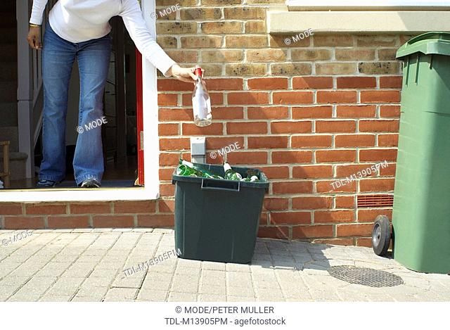 A woman putting out the recycling