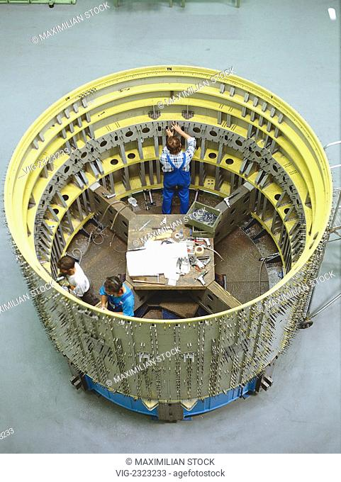 ROCKET CONSTRUCTION. PART OF THE EUROPEAN CARRIER ROCKET -ARIANE- FOR TRANSPORT OF SATELLITES. AssEMBLY OF THE THRUST FRAME OF ALLUMIUM ALLOY AND STEEL -...