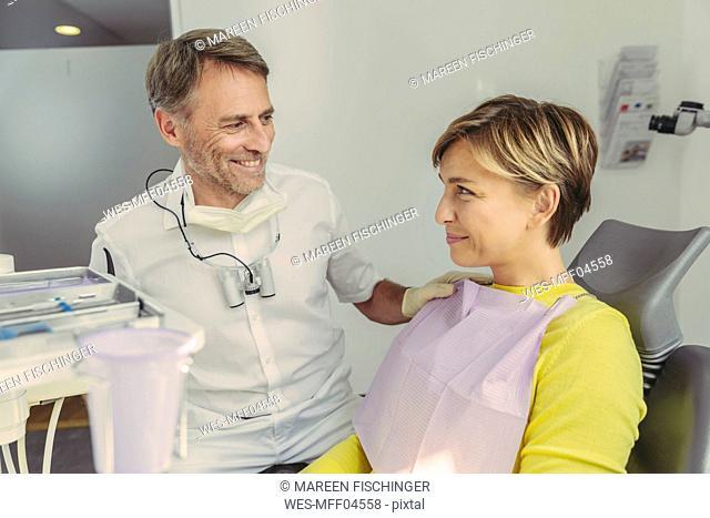 Dentist calming his patient before treatment