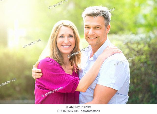 Portrait Of Happy Couple Hugging Each Other