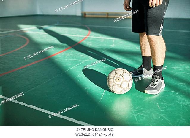 Close-up of indoor soccer player with ball
