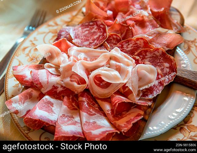 Typical various italian salami, servided on plate at restaurant
