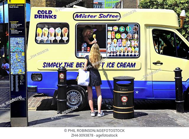 55e0888753 Young woman buying ice cream from an ice cream van in Neal Street