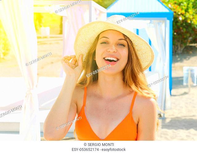 Beautiful cheerful young bikini woman enjoying holidays summer sunlight on resort hotel on the beach in Tenerife, Spain