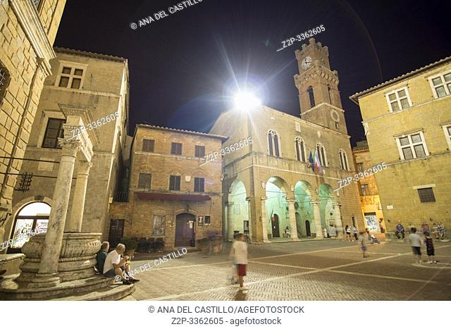 Pienza Orcia valley Tuscany on July 6, 2019 Italy. Illuminated city hall Palazzo Pretorio with the clock tower.
