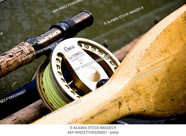 Digitally Altered, Close up of a Fly fishing reel, rod and oars laying in a skif, Southwest Alaska, Summer