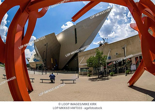 View of Denver Art Museum through the arch of an abstract scuplture