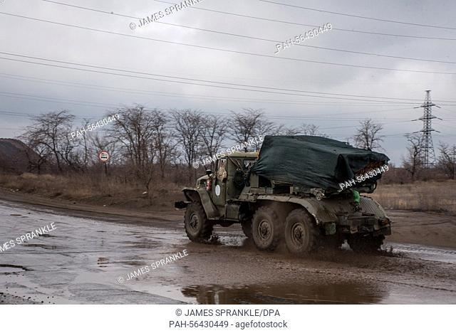 A Ukrainian BM-21 multiple rocket launcher heads back from the front line near Mariupol (Ukraine), 5 March 2015. Photo: James Sprankle/dpa | usage worldwide