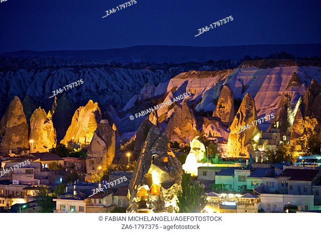 Houses and cave dwelings in fairy chimneys in Goreme at dusk  Cappadocia, Anatolia, Turkey