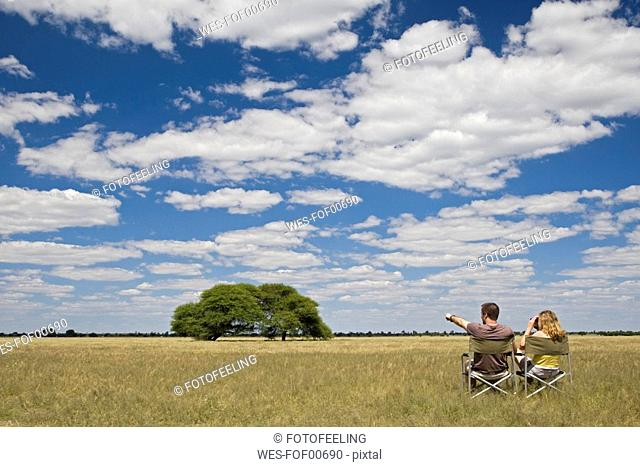 Africa, Botswana, Tourists looking at the landscape