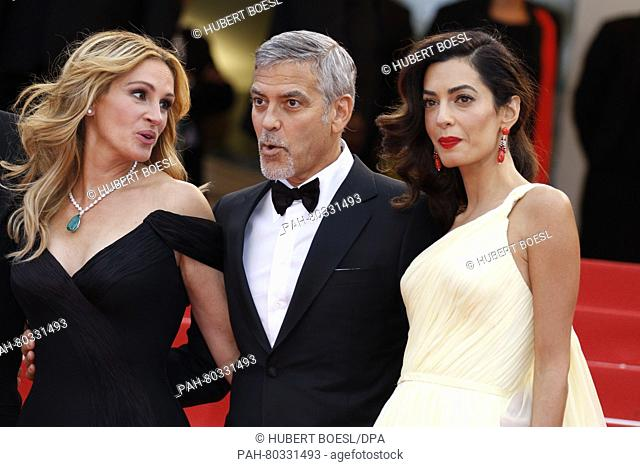 Actress Julia Roberts (l-r), George Clooney and his wife Amal Clooney attend the premiere of Money Monster during the 69th Annual Cannes Film Festival at Palais...