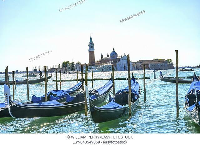 Gondolas San Giorgio Maggiore Church Grand Canal Boats Venice Italy. 16th Century Benedictine Church on Island Venice Lagoon