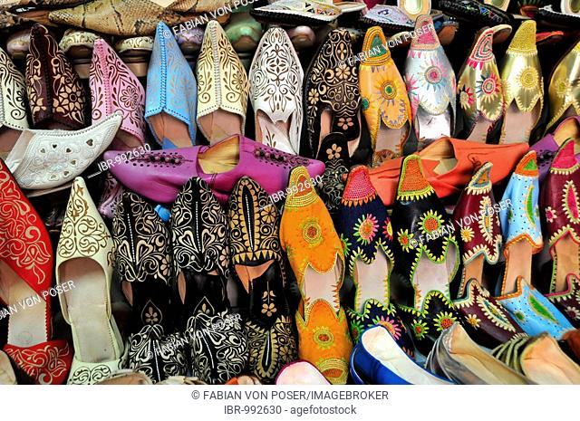 Typical Moroccan leather slippers in a shoe shop at the souk, market, in the medina quarter of Marrakesh, Morocco, Africa