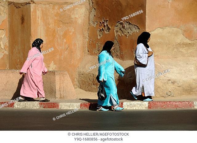 Moroccan Women Walk Past City Walls Marrakesh or Marrakech Morocco
