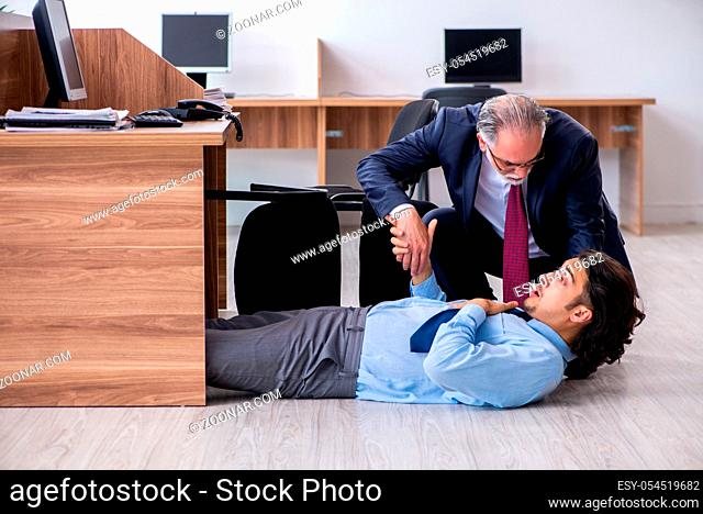 The male employee suffering from heart attack in the office