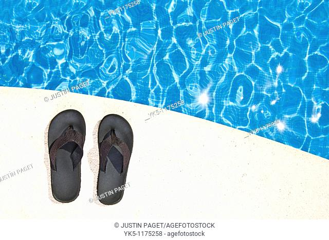 Shot of a Pair of Flip Flops next to the Pool