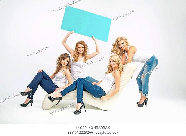 Sensual young women sitting with boards