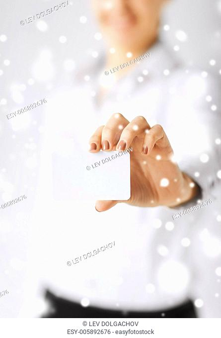 business, office, advertisement concept - businesswoman showing blank card
