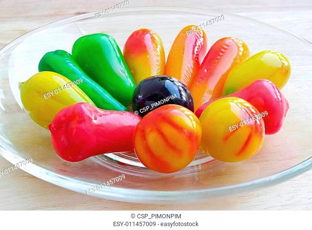 Thai style marzipan fruits. Thai dessert fruit-imitated soybean dumpling coated with jelly