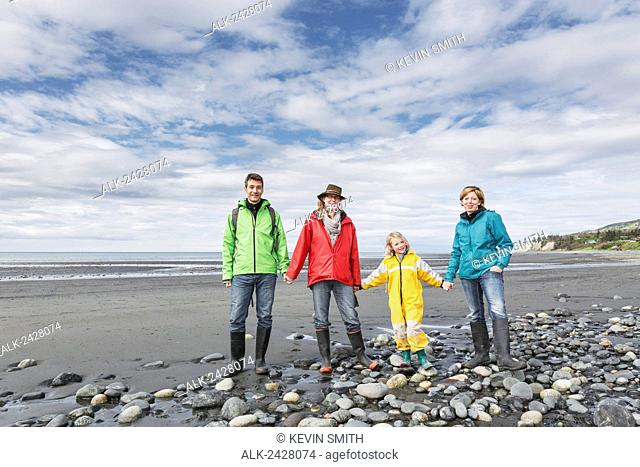 Family walking on Bishop's Beach, Homer, Kenai Peninsula, Southcentral Alaska, USA