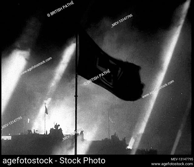 A Silhouette of a Waving Flag Against an Illuminated by Searchlights Brandenburg Gate in Pariser Platz in Berlin With Smoke From Fireworks Hanging in the Air -...