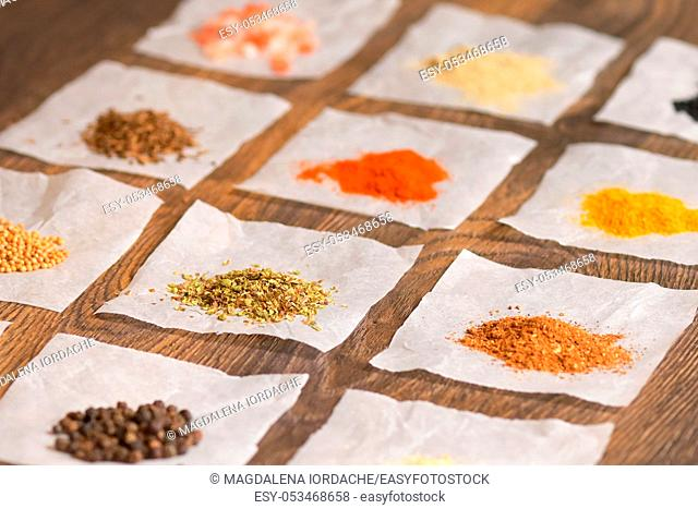 Overhead View Of A Colourful Individual Spices on wooden table