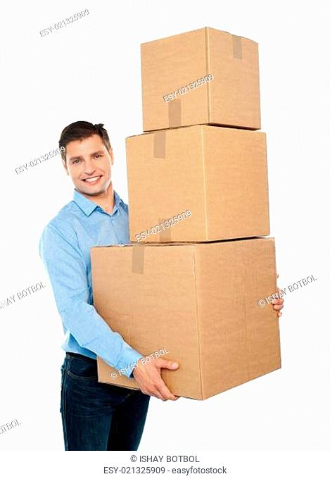 Happy young man carrying heavy packages