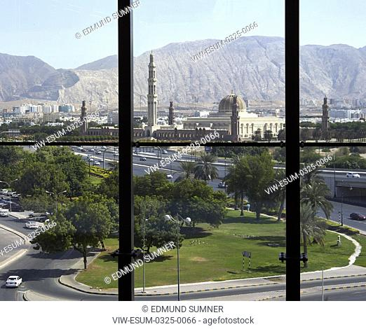 Framed view looking out towards grand mosque and distant mountains. National Bank of Oman HQ, Muscat, Oman. Architect: LOM Architecture and Design, 2017