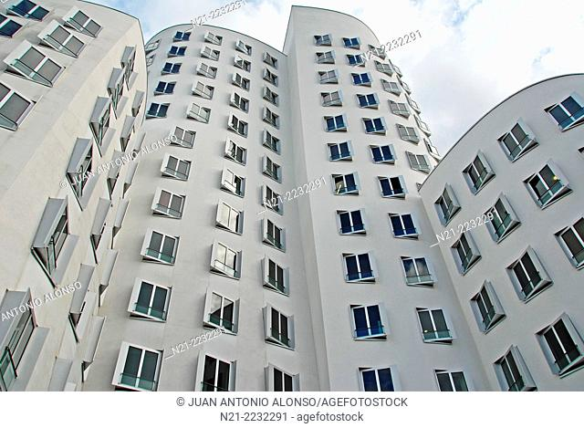 Buildings in The Neue Zollhof Complex by architect Frank O. Gehry at the eastern Rhine River harbourfront. Dusseldorf, North Rhine Westfalia, Germany, Europe