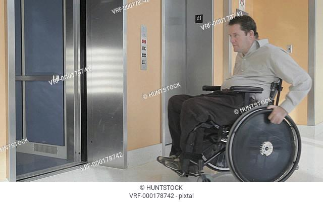 Man with spinal cord injury in wheelchair entering an elevator