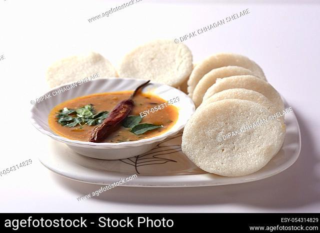 Idli with Sambar and coconut chutney, Indian Dish : south Indian favourite food rava idli or semolina idly or rava idly, served with sambar and green coconut...