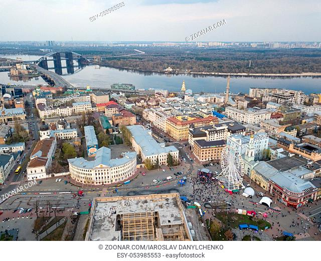 Aerial view from the drone, bird's eye view to the Kiev river port, National University of Kyiv-Mohyla Academy, tourist area, Ferris wheel, old Podol buildings
